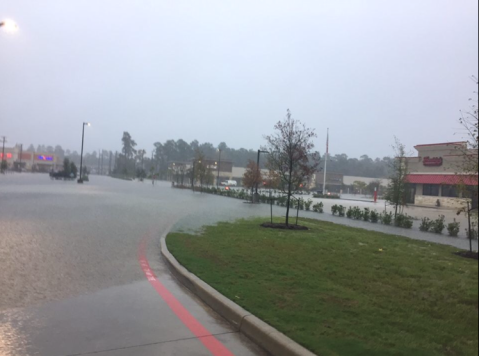 The H.E.B's parking lot in town center has filled with water. It has left people stranded at work and in their cars. (Photo by Amanda Borys 9.19.19)
