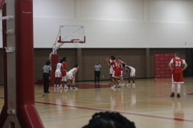 Lone Star College-Kingwood Coyotes vs. Lone Star College-North Harris Hurricanes during a basketball game. Coyotes in possession of the ball, with the. Hurricanes on defense. (Photo by Katheryn Stinnett 11.1.19)