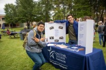 Lone Star College-Kingwood students (right to left) Erick Sorto and Xavier Lopez at LSC-Kingwood's Oktoberfest at the Deliberative Dialog Club's booth. (Photo by Bri Maguire 17.10.19)