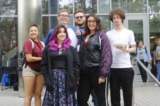 Lone Star College-Kingwood Students (left to right) Kailtlyn Moore, Cooper Davidson, Violette Bright, Alexa Harris, Jay Ramsey, and Robert Bright socializing during LSC-KW's event Welcome Back to the Pack. The students are eating the pizza given out.