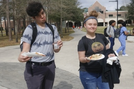 Lone star College-Kingwood students(left to right) Seth Maldonado and Savannah Harrison during LSC-KW's event. The students are enjoying free pizza for lunch.